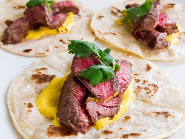 Cumin-Rubbed Steak Tacos with Tumeric-Lime Crema
