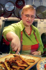 Lidia in cooking in the kitchen