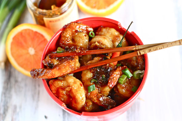 Make Orange Peel Shrimp to recreate Chinese take-out at home. The secret ingredient is marmalade to thicken the sauce and coat the shrimp.