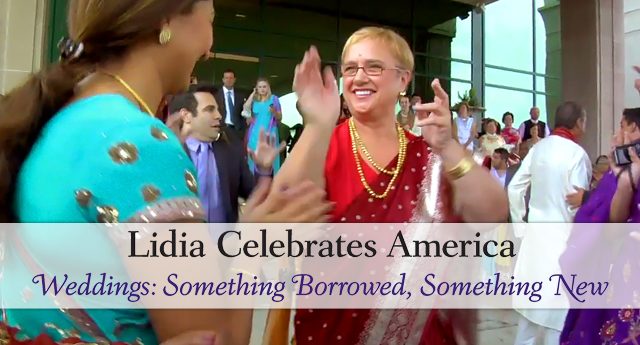 Lidia Bastianich wearing a sari and bindi claps to the music at a hindu wedding