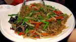 japchae on a white dish