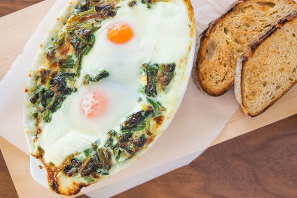 This brunch entree marries baked eggs and creamed spinach where the eggs poach in the spinach, and the yolks thicken into a golden sauce.