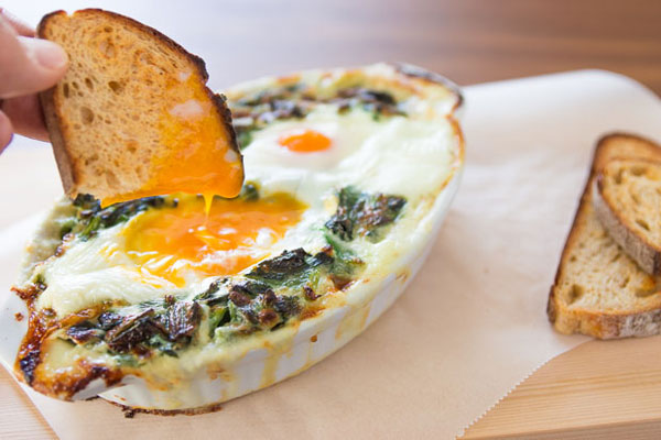 This brunch entree marries baked eggs and creamed spinach covered in ...
