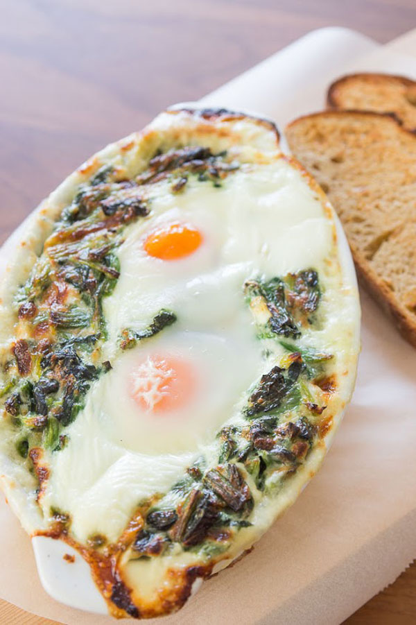 This brunch entree marries baked eggs and creamed spinach covered in Gruyere cheese. Don't forget crusty bread to mop up the sauce!