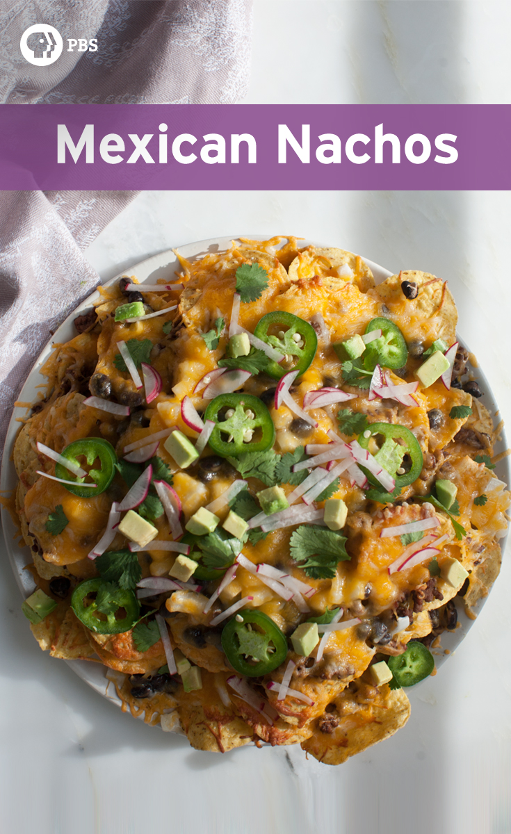 Bake these Mexican Nachos at a low oven temperature with layers of cotija cheese, jalapeno, avocado, cilantro and more.