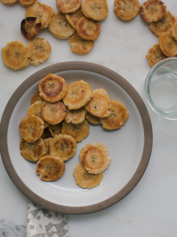Tostones are twice fried plantains common in Latin American cuisine. It is paired with mojo sauce, which is made with sour oranges.