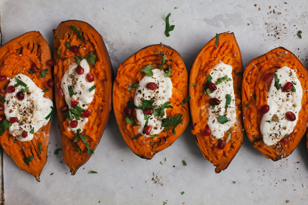 Fill Sweet Potato Boats with Burrata, Pomegranate, and Dukkah for a easy weeknight meal.