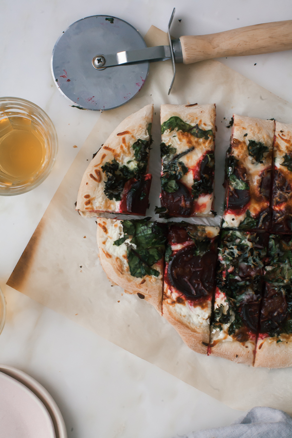 Make this Winter Leaf Pizza Recipe featuring kale, beet greens, and thinly sliced beets for a vegetable pizza.