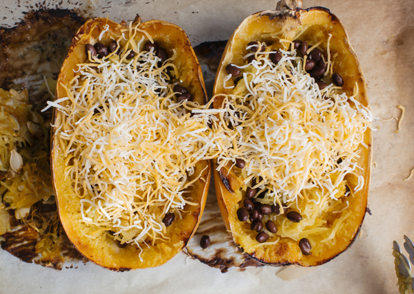 Roasted Spaghetti Squash Boats are a Mexican-inspired dish that comes together in under an hour with black beans, cheese and pico de gallo.