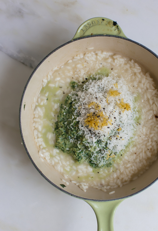 This Spring Risotto recipe features asparagus, onions, spinach, and Parmesan-Reggiano.