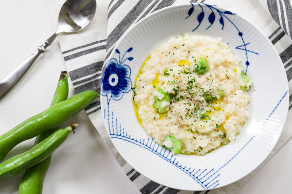 This light risotto recipe features sweet Spring Onions and fava beans with Parmesan Reggiano.