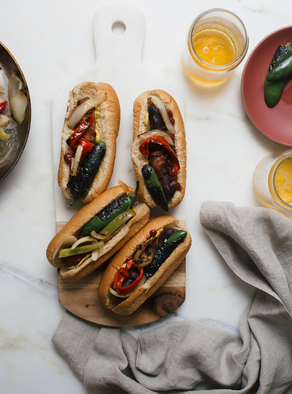 Wrapped in bacon, a Los Angeles hot dog is topped with charred jalapeños, red bell pepper, green bell pepper and onions.