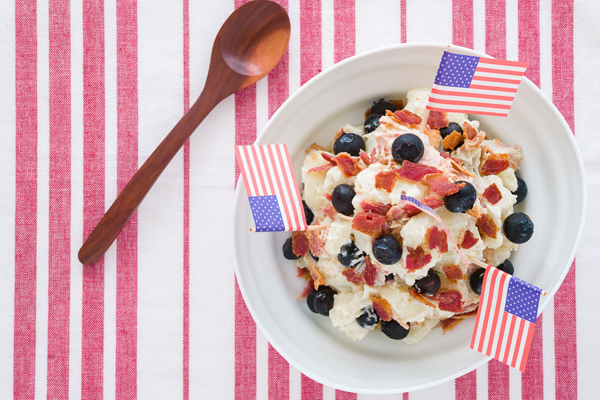 Make it patriotic with Red White and Blueberry Potato Salad for a colorful side dish.