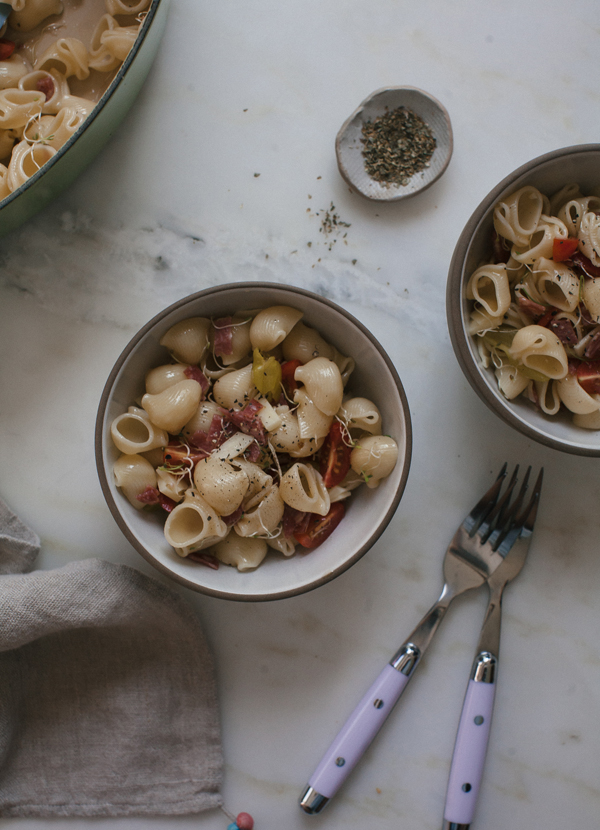 This Italian Pasta Salad recipe is an easy to transport picnic dish with pepperoncinis, red onion, provolone, and cherry tomatoes.