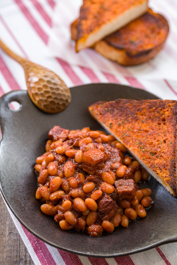 The Kimchi Baked Beans are a Korean twist on a classic dish with the perfect blend of sweet and savory.