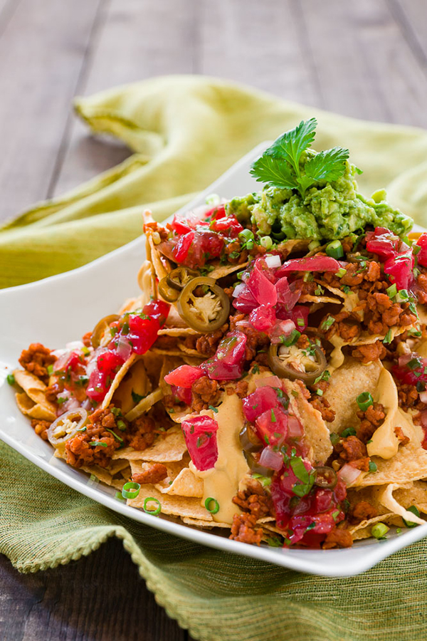 Loaded Vegan Nachos are the way to make your favorite Mexican dish healthy with vegan meat and vegan cheese sauce.