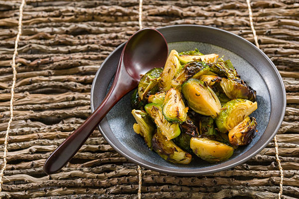 These Honey Caraway Brussels Sprouts are caramelized at a high temperature, which brings out their inherent sweetness for an easy side dish.