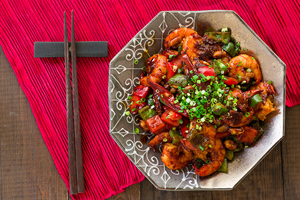 Shrimp takes a turn in a twist on the Chinese-American takeout classic of Kung Pao Chicken for a weeknight meal that comes together in 15 minutes.