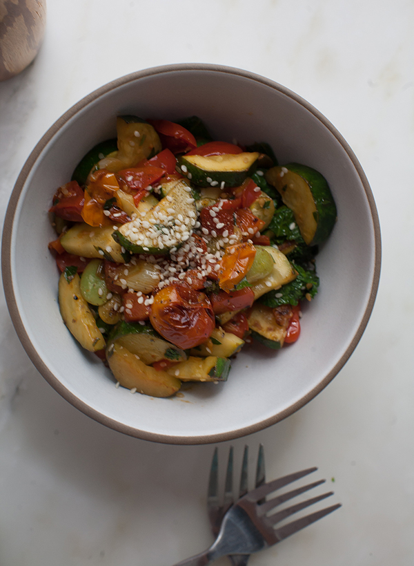 This is the simplest of succotashes with a nice addition of mustard greens with tons of zucchini and lima beans and tomatoes galore.