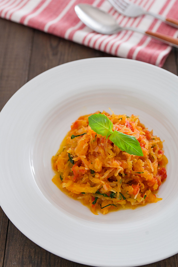 Spaghetti Squash al Pomodoro looks like pasta for a cross-seasonal dish.