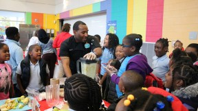 A volunteer speaks to the students about making healthy smoothies. Credit of Martha's Table.