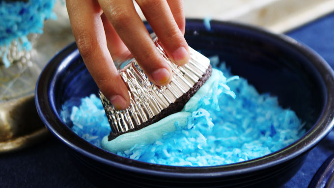 Dipping-cupcakes-in-Coconut