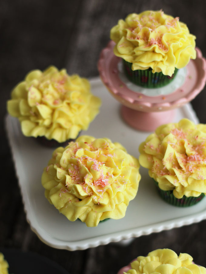 frosted yellow cupcake