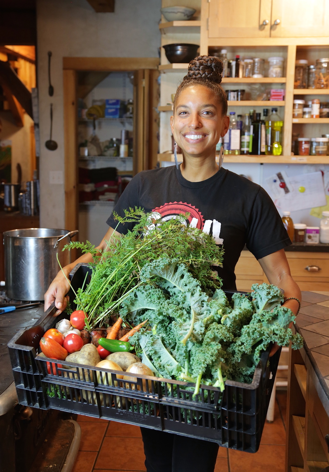 Leah Penniman holding vegetables