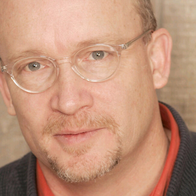 Headshot of director Alex Gibney.