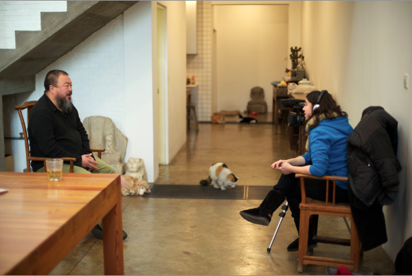 Wide shot of Ai Weiwei being interviewed by Alison Klayman at his studio