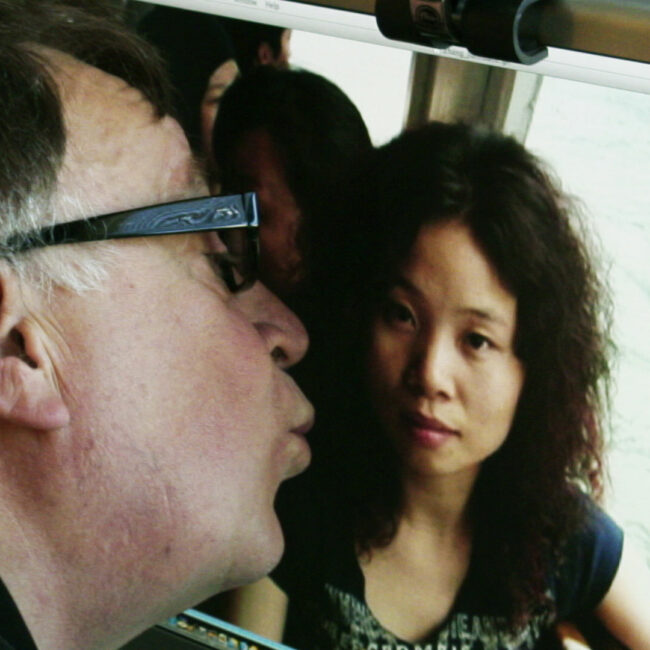 Steven of kissing photo of Asian woman on computer screen.