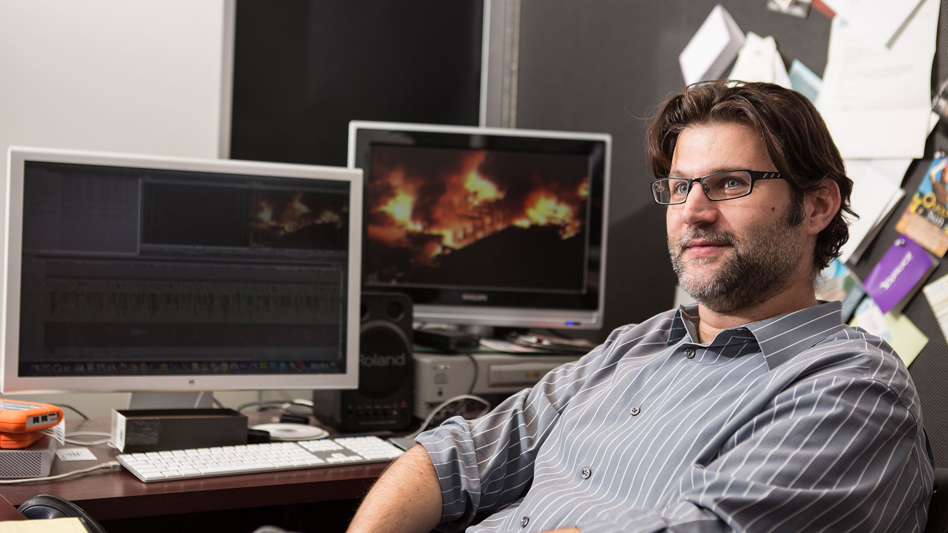 Let the Fire Burn filmmaker Jason Osder sitting in the edit suite
