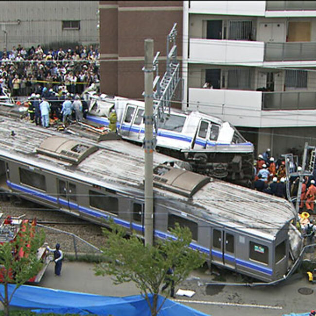 Site of Amagasaki train crash with emergency services