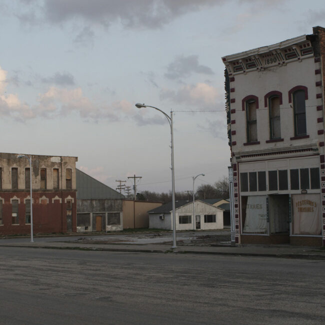 Decaying buildings face an empty street in small town Rich Hill