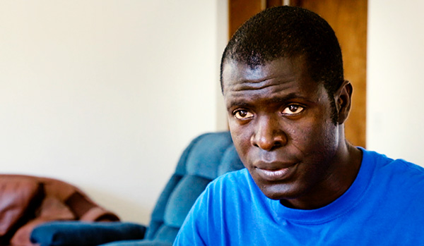 Emmanuel Urey, interviewed (in blue shirt) for film In the Shadow of Ebola