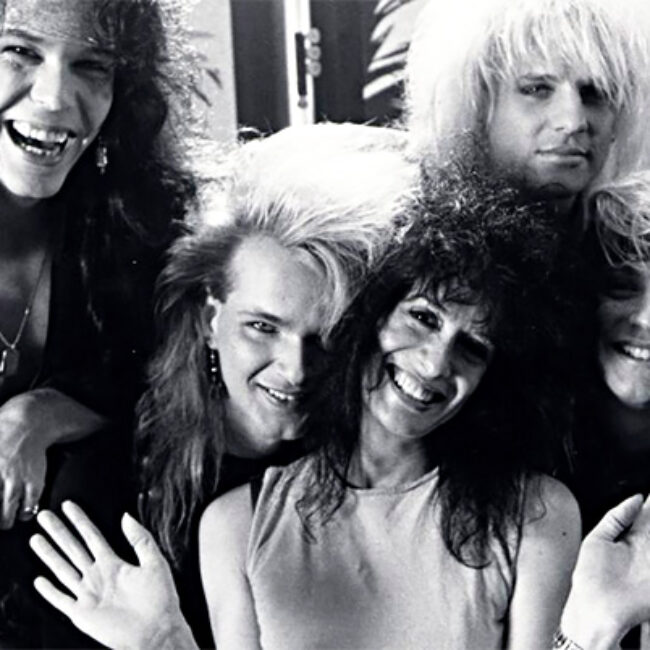 Filmmaker Penelope Spheeris surrounded by Poison (the band), in Decline of Western Civilization III the Metal Years