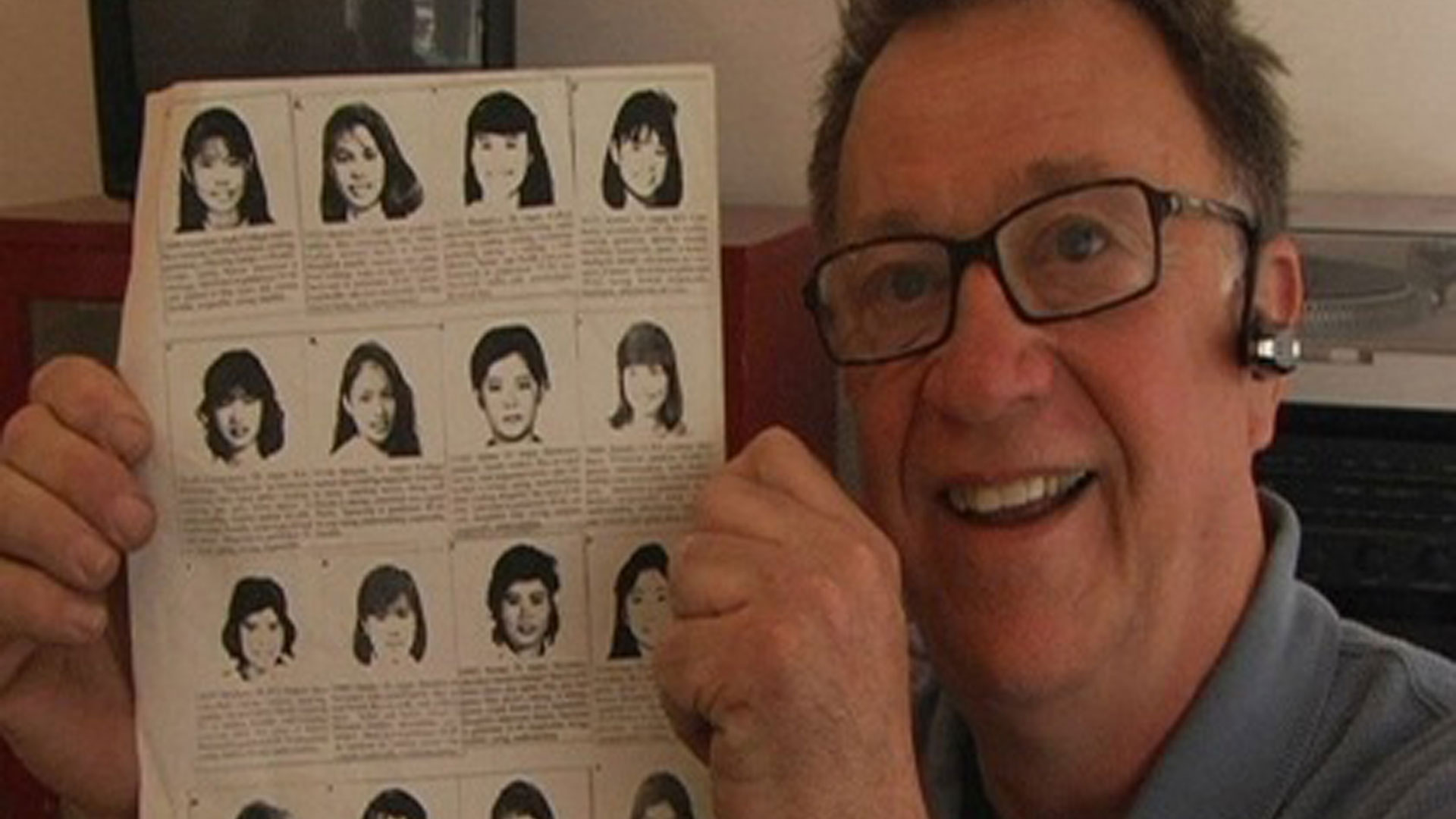Steve holds up flier with headshots and bios of Asian women.