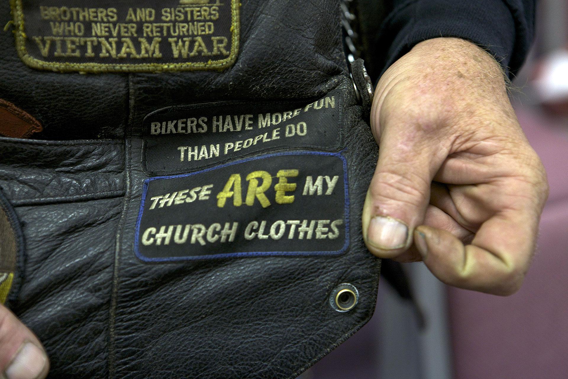 Close-up of biker vest patch that reads,