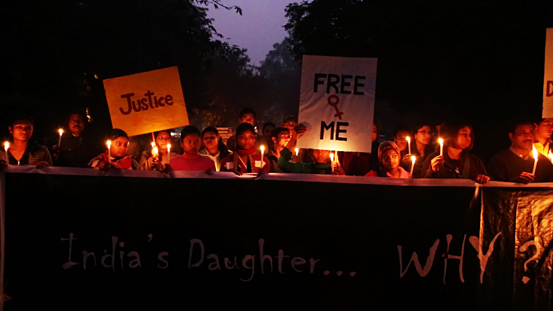 rape protesters in India hold a candle-lit vigil