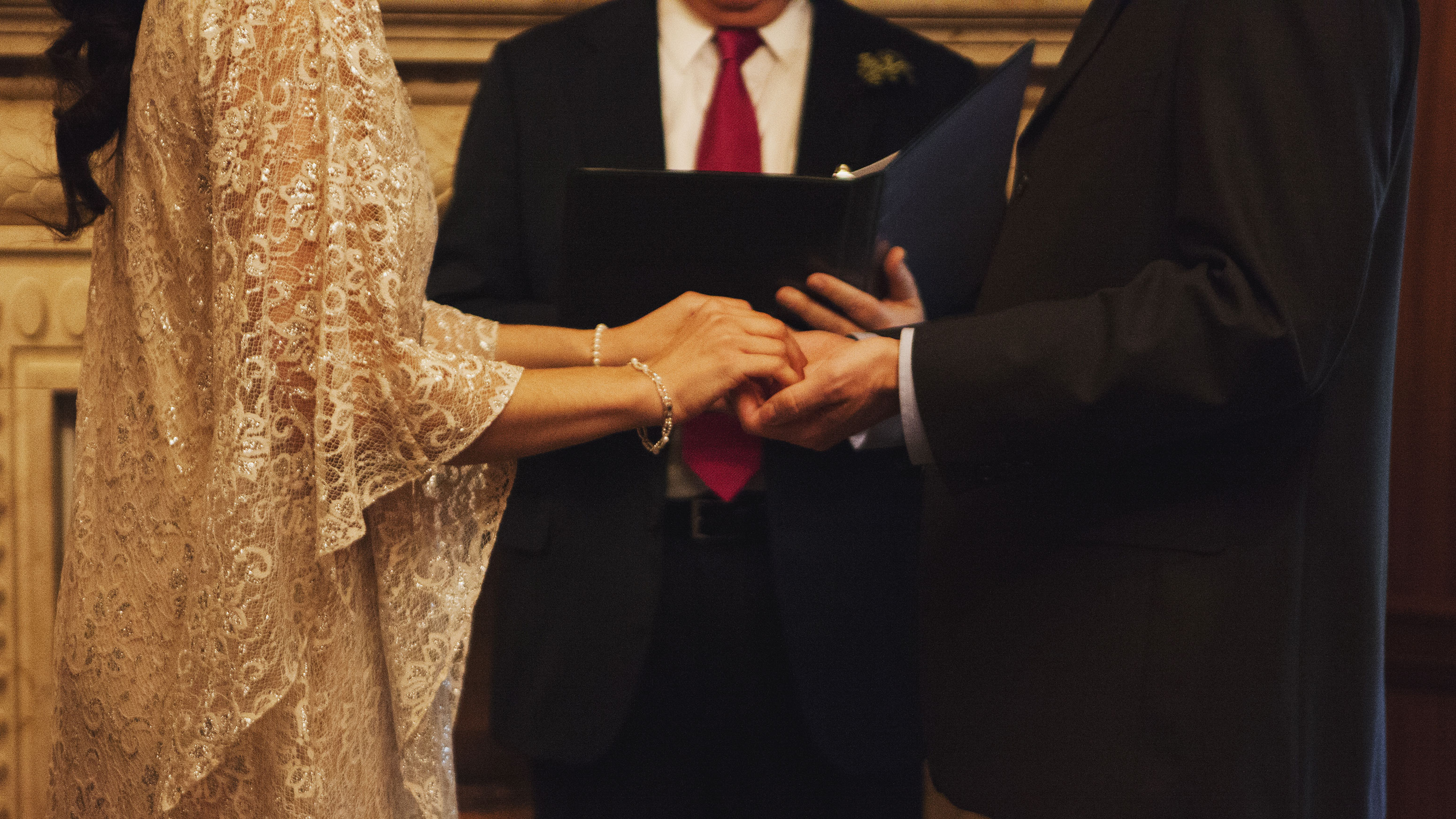 Dave and Lindsey's hands joined together in an exchange of wedding vows.