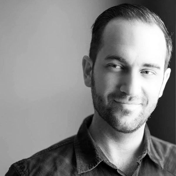 Filmmaker Matt Fuller, director of Autism in Love, in black and white portrait