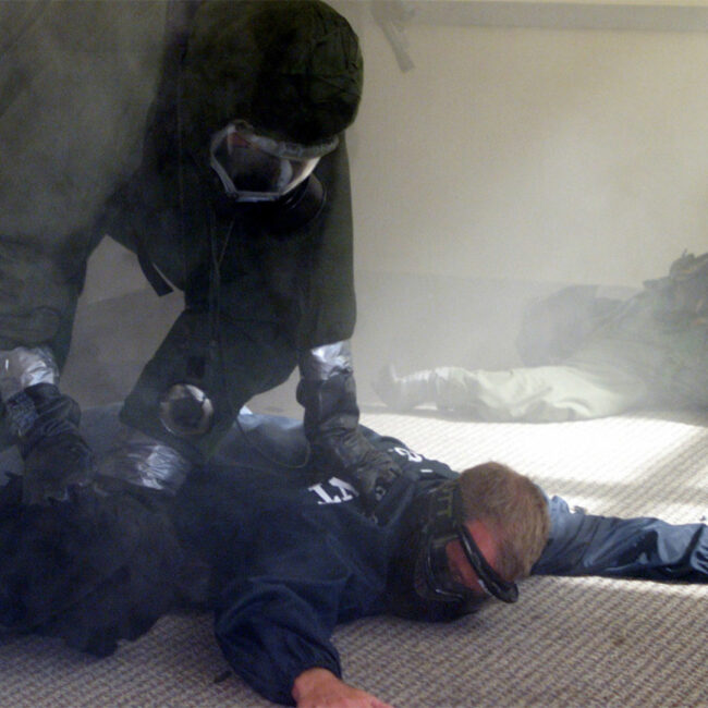 An agent holds down a terror suspect in a government counterterror training exercise.