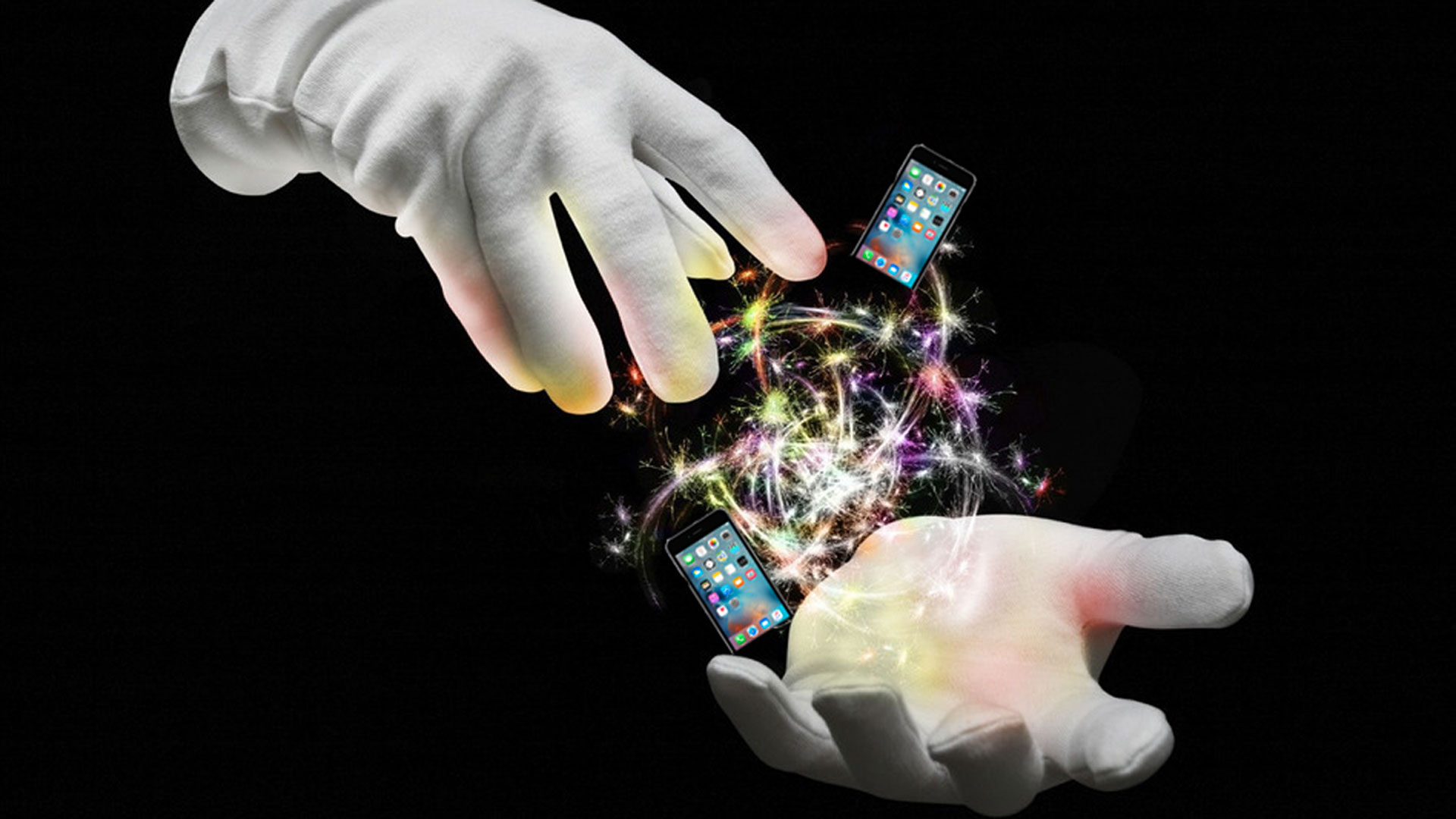 magician's gloved hands conjuring up magic and iphones