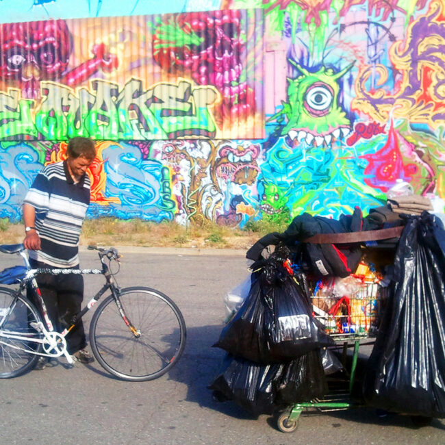 From Dogtown Redemption: A recycler named Jason takes a break from hauling with his bicycle and cart.