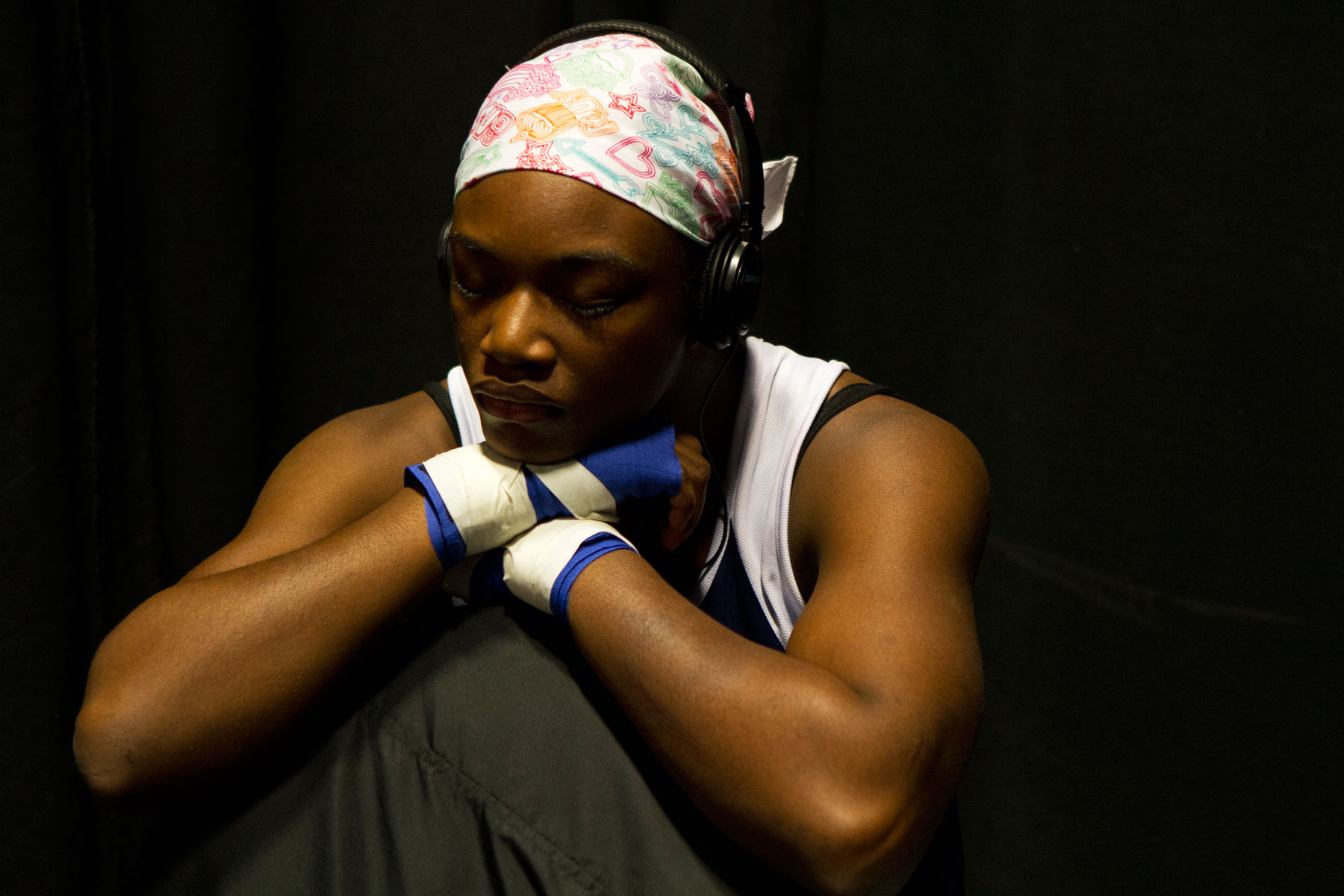 Claressa Shields deep in thought while listening to music with headphones
