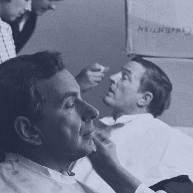 Gore Vidal (front) and William F Buckley (back) are prepped in makeup chairs for their ABC debates