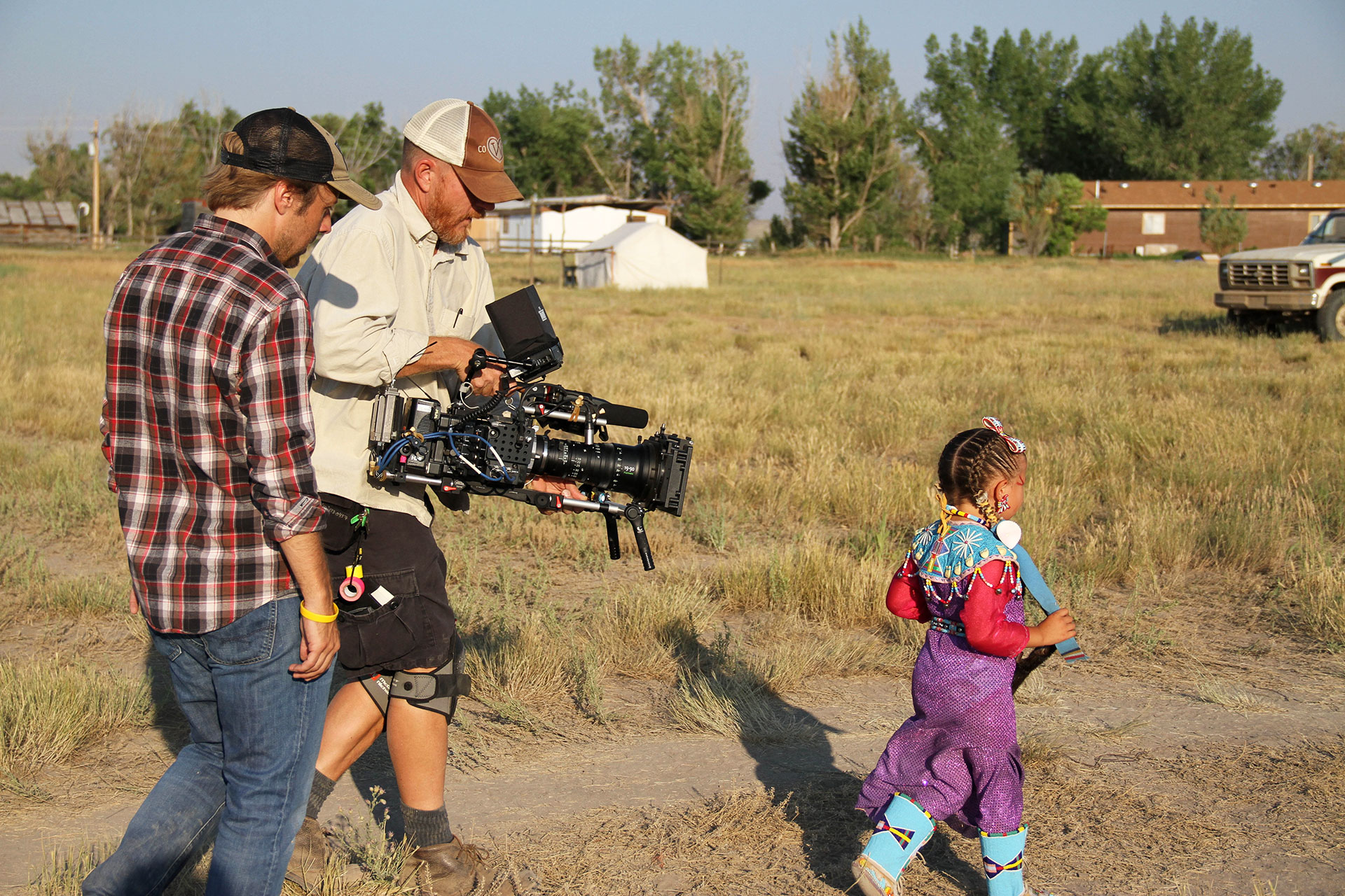 Wind River Director, Mat Hames, and DP, Wilson Waggoner, film a Northern Arapaho child at the Ethete Powwow.