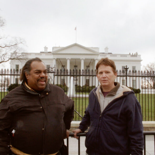 Former Klansman Scott Shepherd (right), with Daryl Davis, in front of the White House, in Accidental Courtesy