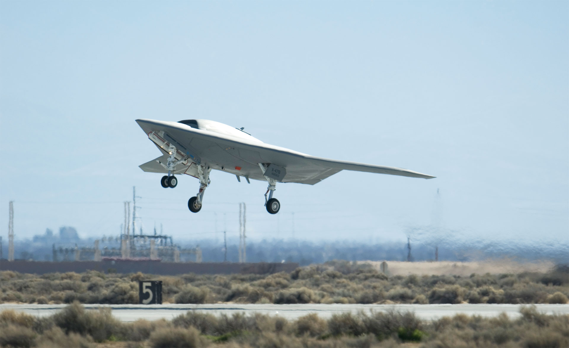 A Navy X-47B Unmanned Combat Air System Demonstration aircraft takes off and flies for the first time Feb. 4, 2011, at Edwards Air Force Base, Calif. The Northrop Grumman-built aircraft flew for 29 minutes during the flight test. (Via Wikimedia commons)