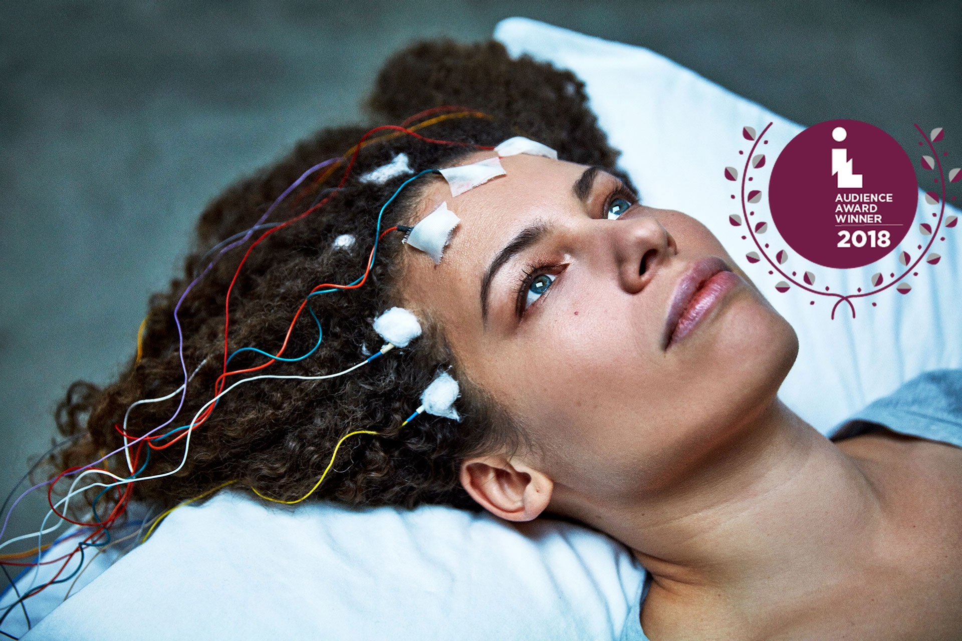 Unrest signature image with Jen Brea getting a test on her brainwaves, including IL audience award graphic now